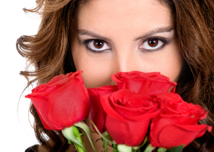 fashion portrait of girl with red roses over a white background