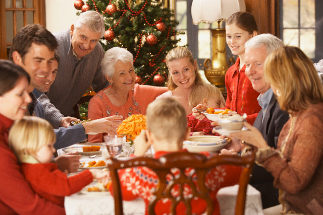 Large family eating Christmas dinner, Richmond, Virginia, United States --- Image by © Ariel Skelley/Blend Images/Corbis
